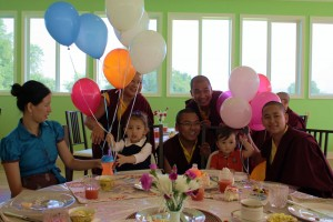 Minling Dungse Rinpoche celebrates his 1st birthday along with his elder sister, Jetsün Rinpoche, Ven. Acarya Namdrol Gyatso la, Ven. Thrinley Gyaltsen al, Anila Choenyid Choedron, Anila Thaye Choedron and Yeshe Choedron.