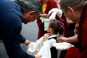 Jetsün Rinpoche offers a khatag to HE Dzigar Kongtrul Rinpoche.