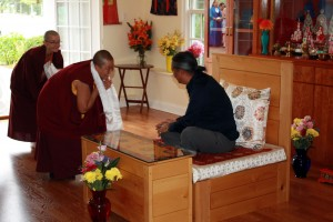 Anila Choenyid offering a khatag to HE Dzigar Kongtrul Rinpoche.