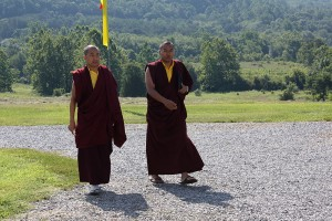 Ven. Acarya Namdrol Gyatso and Ven. Thrinley Gyaltsen arrive at the shrine room for the first day of teachings.