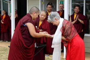 Jetsün Khandro Rinpoche presents Patricia Deer with the keys to her retreat room