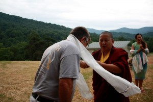 HE Jetsün Khandro Rinpoche presents the ceremonial scarf to Mark Good, the builder of Tashi Chö Dzong.