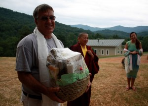 On behalf of Lotus Garden, HE Jetsün Khandro Rinpoche and Jetsün Dechen Paldrön present a gift basket to Mark Good, builder of Tashi Chö Dzong.