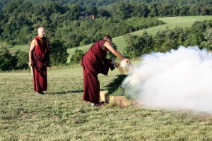 Ven. Acarya Namdrol Gyatso and Drupön Roar Vestre add sang substances to the fire.