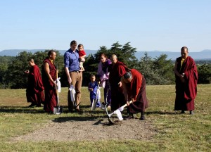 HE Dzigar Kongtrul Rinpoche breaks the ground.
