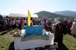 HE Jetsün Khandro Rinpoche playfully tosses celebratory tsampa at Ven. Acarya Namdrol Gyatso.