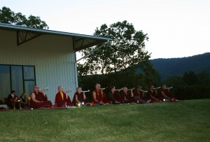 Jetsün Khandro Rinpoche with monks and nuns.