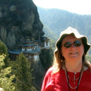 Lopön Rita at Taktsang, Tiger's Nest Monastery, in Paro, Bhutan during a pilgrimage with Mindrolling Jetsun Khandro Rinpoche and sangha members in 2003.
