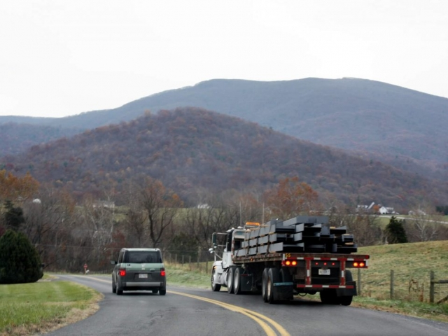 NOVEMBER 28-Truck carrying steel beams approaches Lotus Garden.