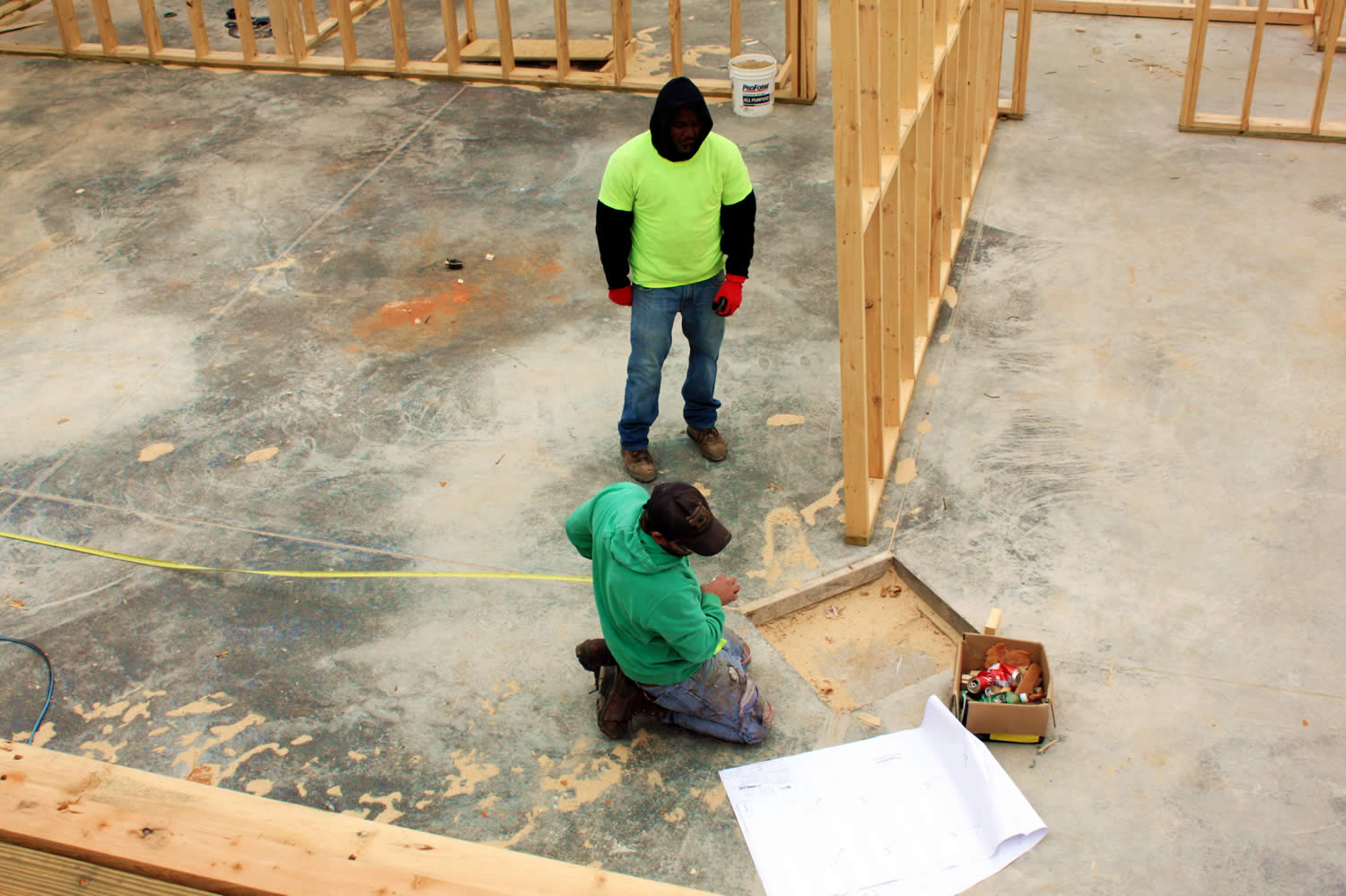 NOVEMBER 28—Installers measure position between vertical beams.