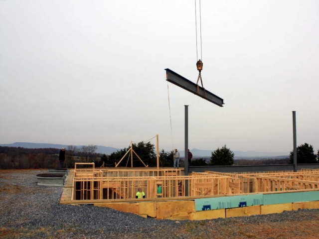 NOVEMBER 28--Lowering a horizontal beam into position.