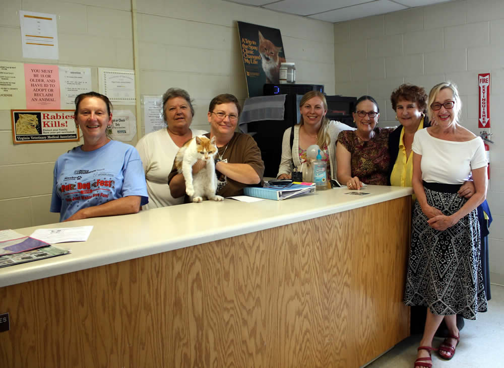Members of the sangha pose with staff of the Page County Animal Shelter, one of the charities to whom Lotus Garden makes an annual donation in honor of Dungse Rinpoche's birthday.