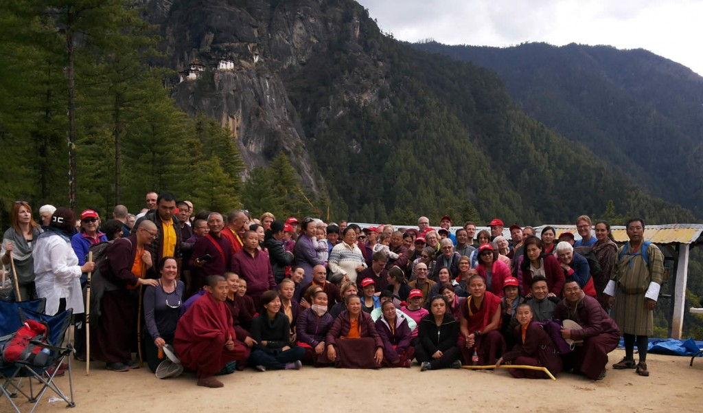 The Mindrolling family, the monks and nuns of Mindrolling along with sangha members pose at the foot of Taktsang after their descent from the sacred site. Bhutan, April 2016.