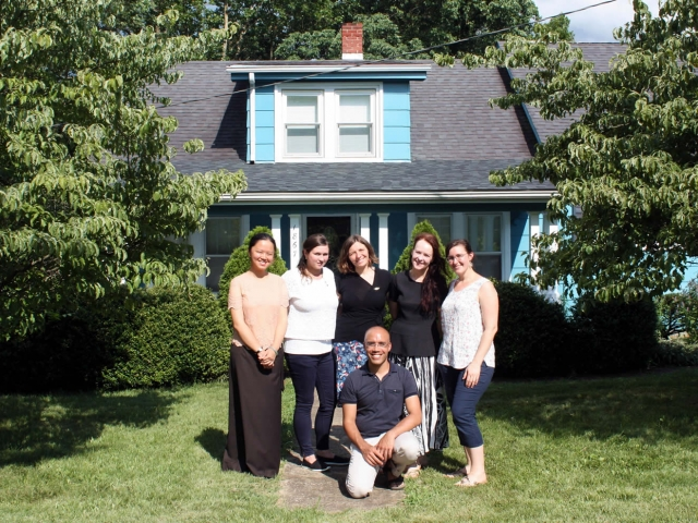 Lotus Garden purchased an adjoining property with a house. Here the European residents pose in front of their new residence, called the Blue House.