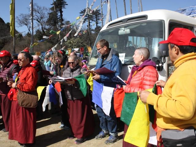 Preparing to hang prayer flags at Pelela Pass. Bhutan, March 2016