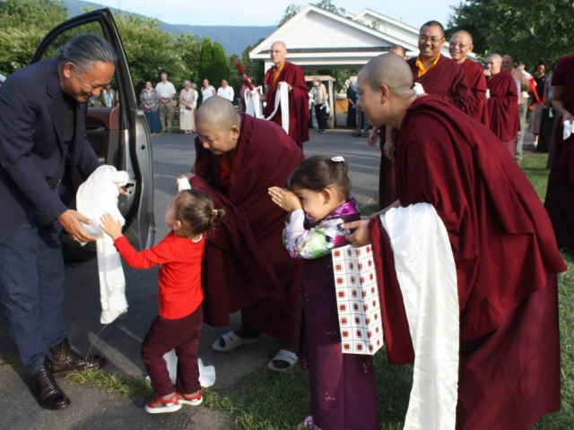 His Eminence Dzigar Kongtrul Rinpoche is greeted by Dungse Rinpoche, Jetsün Rinpoche, Her Eminence Jetsün Khandro Rinpoche, monks, nuns and sangha members.