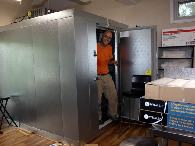 Lama Roar working inside the new walk-in cooler which was installed in the rebuilt kitchen annex.