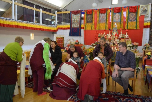Offering khatags to the Mindrolling Family during the Mahasangha at Oberlethe, Germany. October 2016.
