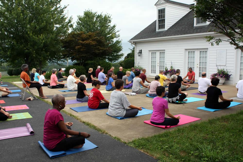 Acarya Ven. Namdrol Gyatso la leading pranayama yoga class.