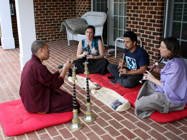 Ven. Thrinley Gyatso la and students during instrument instruction.
