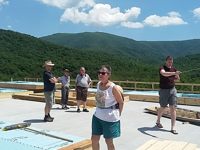 JUNE 10-Britton Bosarge and sangha members take a last look at the vast 360 degree view on the 2nd floor before the walls are raised.