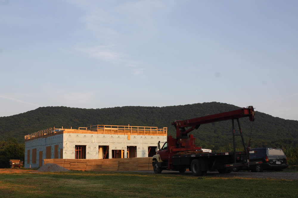 JULY 11--The crane arrives early in the day to raise walls of the 2nd story.
