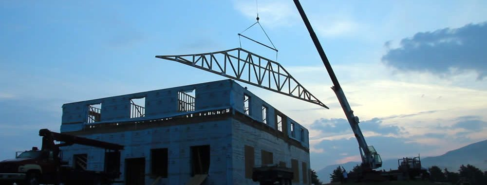 Raising the first roof truss of the temple.