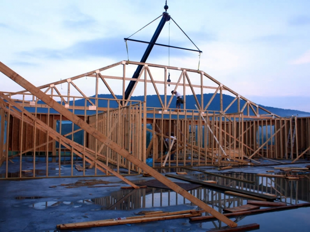 JULY 14—Interior view of first roof truss in position.