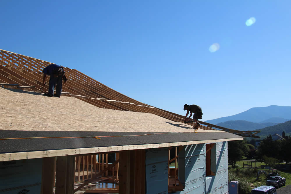 JUNE 20-Workers sheeting the roof of the temple.