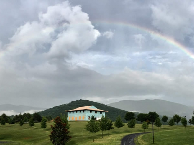 JULY 14-Lama Roar's photo of a complete rainbow over the temple site.