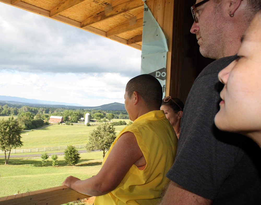 JULY 29-Rinpoche and students admire the view from a 2nd floor window.
