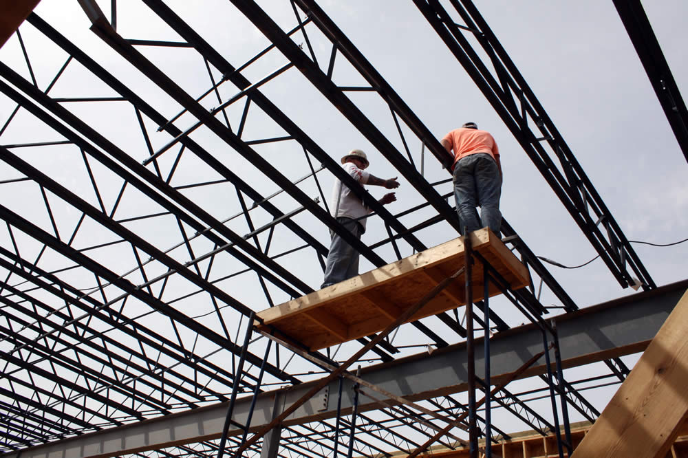 5 APRIL—Workers securing sections of metal joists for the second floor.