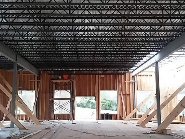 25 APRIL—Interior view of temple showing the completed installation of joists and metal decking for second floor.