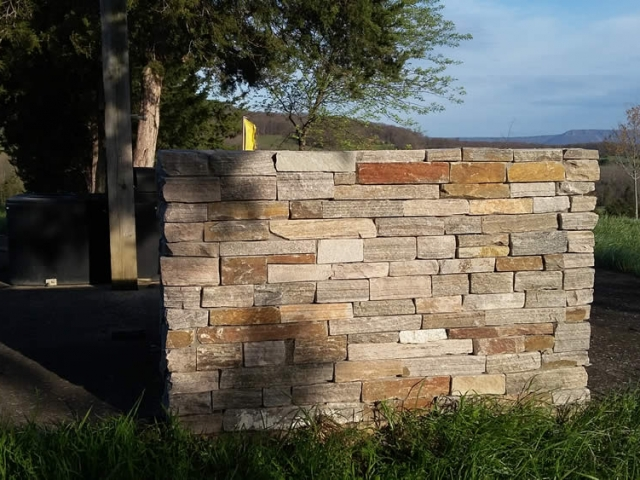 Test wall erected to show selected stone for the temple.