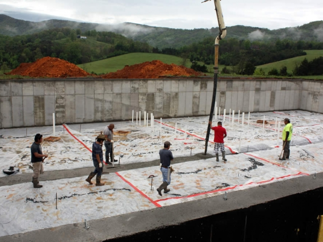 MAY 2-Workers pouring concrete for the footer which will provide the main central support wall for the temple.