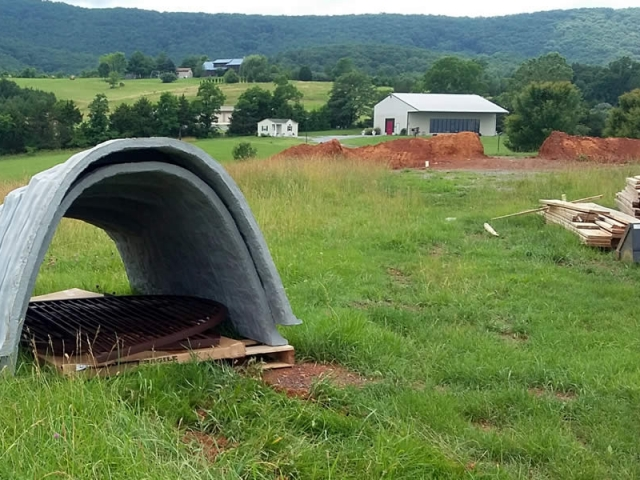 These odd-looking objects which appeared on the land are actually egress wells required by Virginia building codes and will provide for emergency exit from the temple basement.