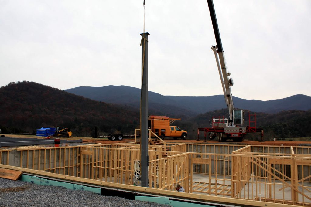 NOVEMBER 28--Lowering a vertical beam into position.