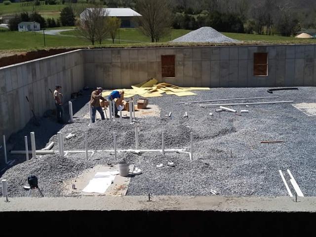 18 APRIL-Plumbers installing pipe.