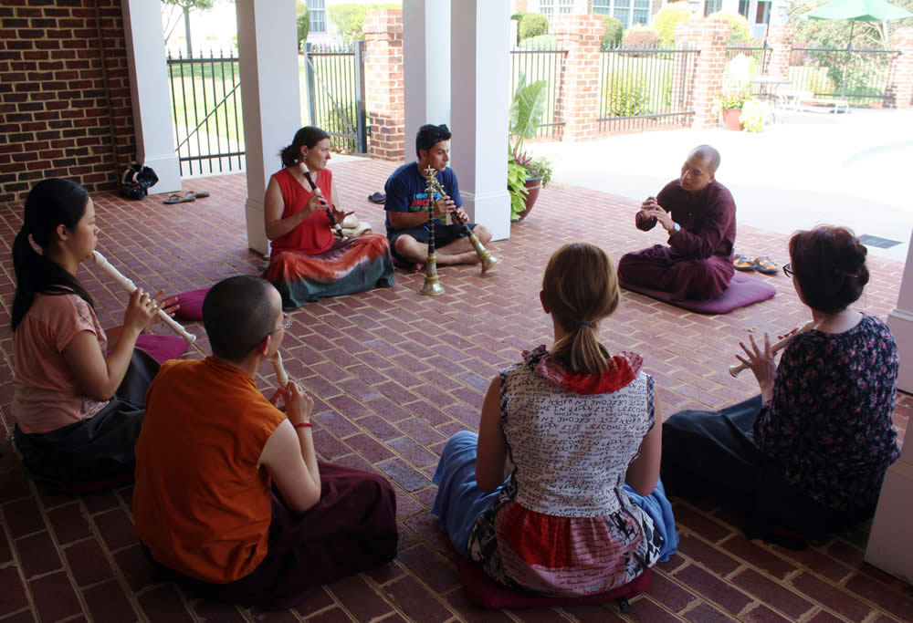 Ven. Thrinley Gyaltsen during instrument class