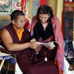 Ven. Acarya Namdrol Gyatso works with a student during Tibetan language class