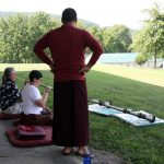 Ven. Acarya Namdrol Gyatso instructs students during instrument class.