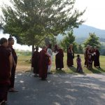 Rinpoches, monks and nuns await the arrival of Dzigar Kongtrul Rinpoche