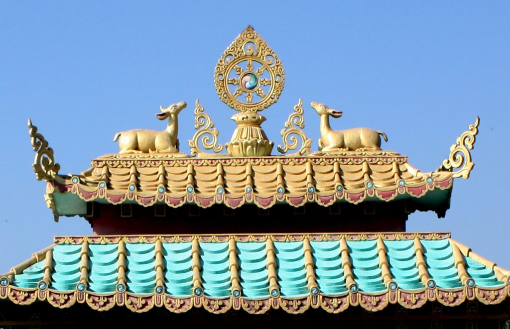 The Mindrol Gatsal ornament of the dharmachakra, deer and parasol will be similar to that on the main gate to Mindrolling Monastery.