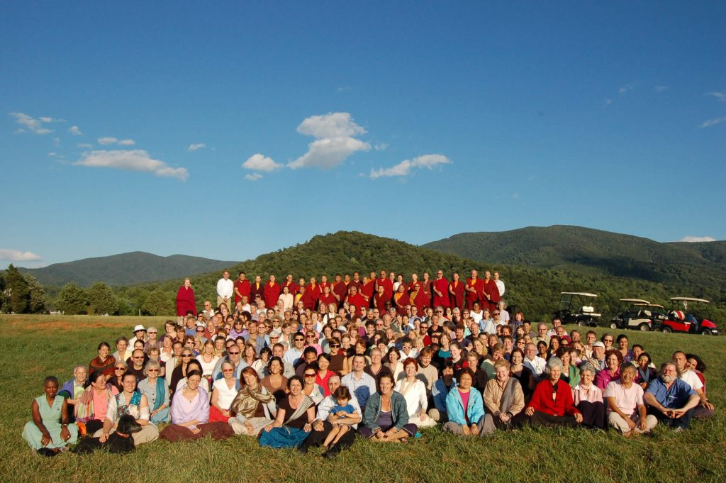 Kyabje Taklung Tsetrul Rinpoche gathers with sangha members on the site of the future Mindrol Gatsal, 2010