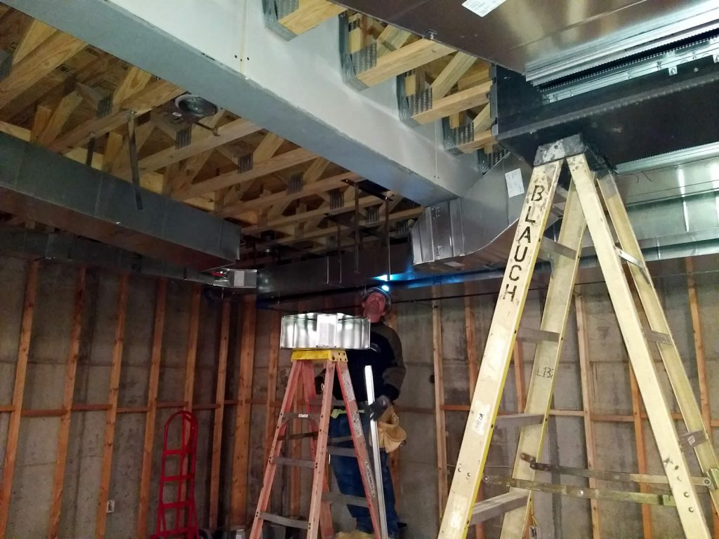 14 March 2019 - Installing HVAC ducts in basement of temple.
