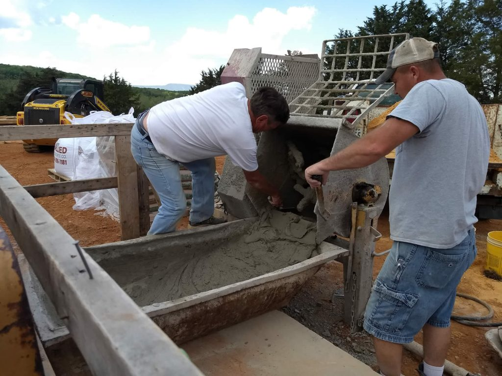 Stone masons mix concrete