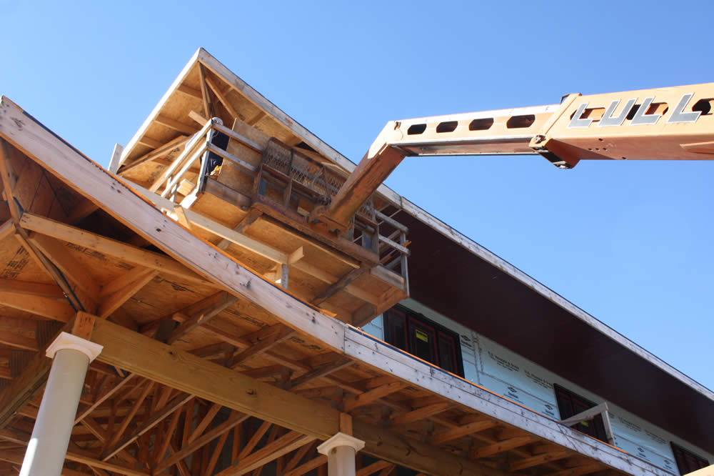 19 January—Workers begin installing soffits to the undersides of the overhanging eaves.