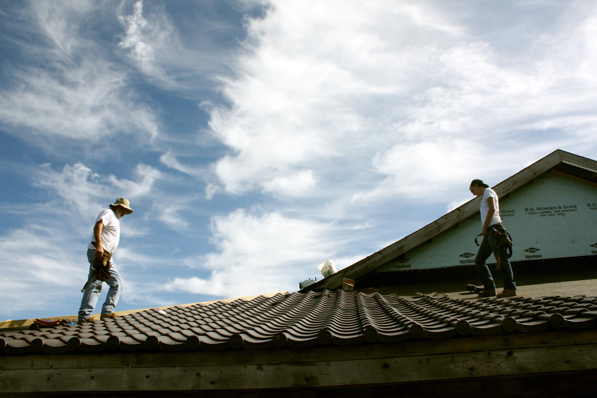 Installing the Japanese roof tiles on the temple