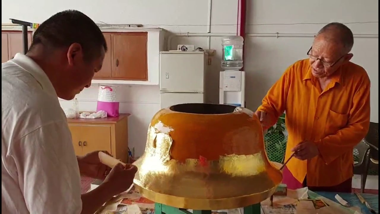 Applying Gold Leaf to A Temple Ornament