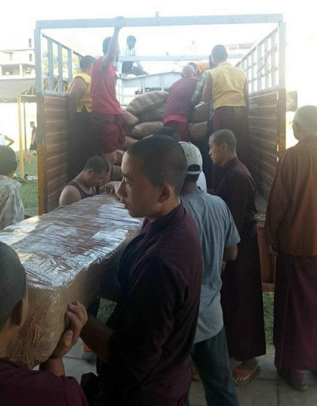 At Mindrolling Monastery, newly constructed door frames are loaded into a truck to begin their journey to Lotus Garden. The door frames will be shipped by sea.